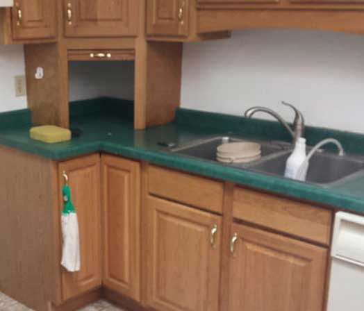 hamilton kitchen on a resurfacing countertop before refinishing